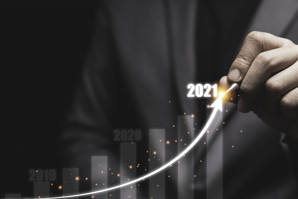 2021 economic and investment growth concept , Businessman writin